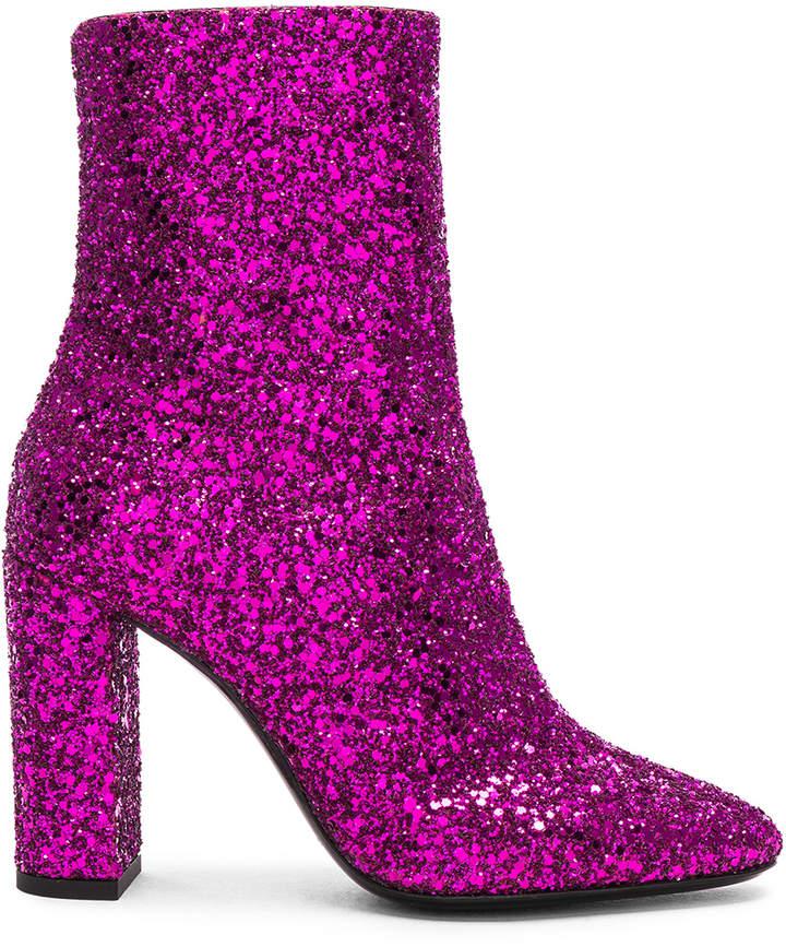 Saint Laurent Glitter Lou Ankle Boots in Fuchsia | FWRD