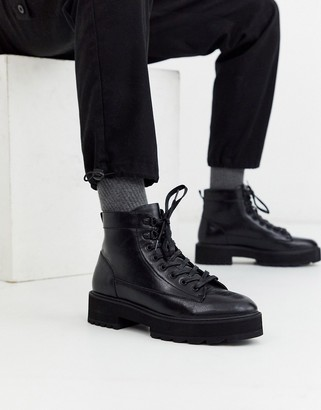 ASOS DESIGN lace up boot in black faux leather with orange neon lace on chunky sole