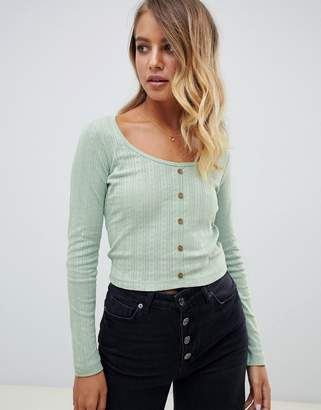Asos Design DESIGN button front long sleeve top in pointelle rib-Green