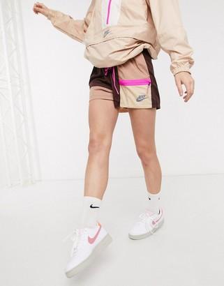 Nike colourblock woven shorts in beige