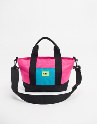 Lazy Oaf Labs panel cross body bag in pink and blue