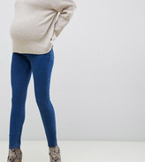 Asos DESIGN Maternity Ridley high waisted skinny jeans in flat blue wash with under the bump waistband