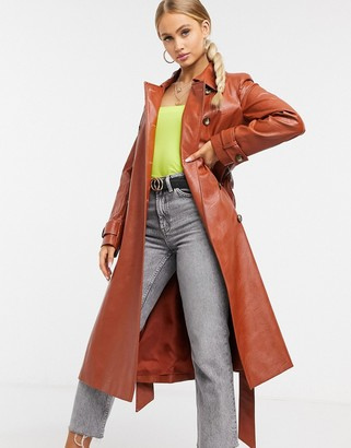 Helene Berman vinyl trench coat in rust red