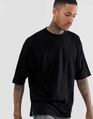 Asos DESIGN oversized longline t-shirt with side split in black