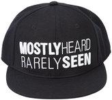Mostly Heard Rarely Seen logo cap