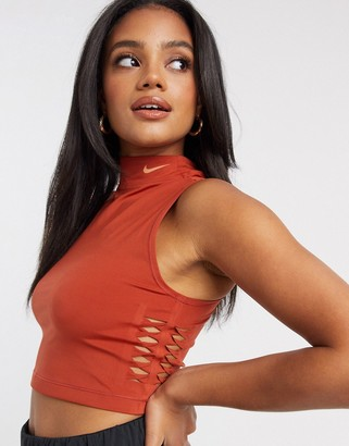 Nike Training Nike Pro Training funnel neck crop top in brown