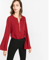 Express bell sleeve zip front blouse