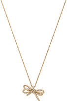 Marc Jacobs Pave Twisted Bow Pendant in Metallic Gold.