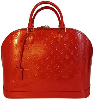 Louis Vuitton Alma Orange Patent leather Handbags