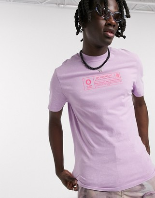 Asos DESIGN t-shirt with neon chest print in lilac acid wash