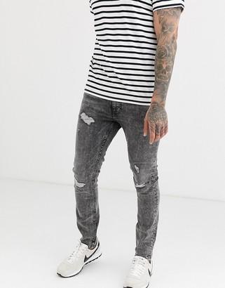 Burton Menswear skinny jeans in light grey with rips