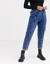 Weekday Byron organic cotton acid wash tapered jeans in blue