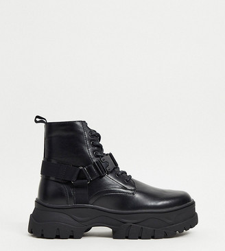 ASOS DESIGN Wide Fit lace up boots in black faux leather with strap detail on chunky sole