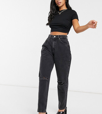 """ASOS DESIGN Petite high rise """"slouchy"""" mom jeans in washed black with rips"""