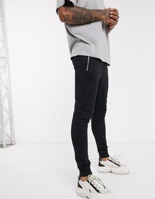 ASOS DESIGN organic super skinny sweatpants in black with silver zip pockets