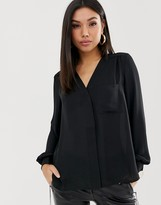 Asos Design DESIGN long sleeve blouse with pocket detail in Black