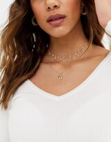 Asos DESIGN multirow necklace with crystal drop choker and crescent moon in gold tone