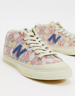 New Balance 210 sneakers in pink patchwork
