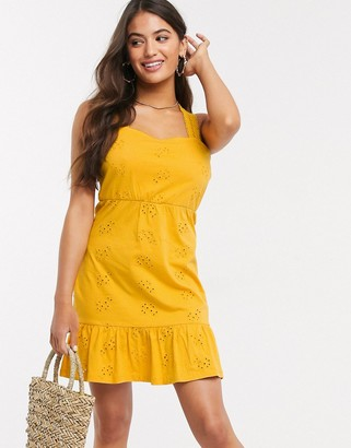 ASOS DESIGN cross back tiered broderie mini dress in yellow