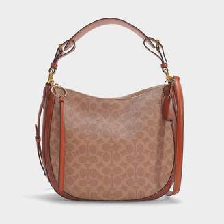 Coach Coated Canvas Signature Sutton Hobo Bag In Brown Canvas