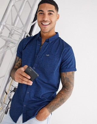 Hollister icon logo slim fit short sleeve shirt in navy