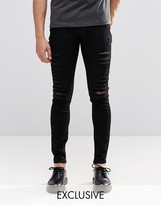 Cheap Monday Low Spray Slash Extreme Super Skinny Jeans in Black Extreme Rips