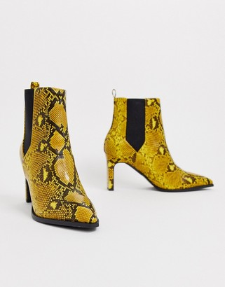 ASOS DESIGN Romeo pointed heeled boots in yellow snake