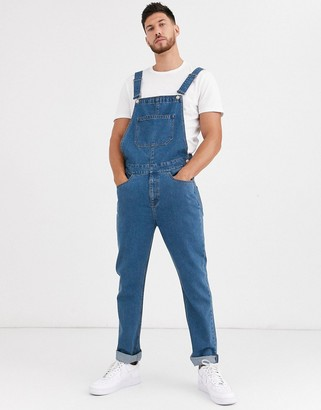 ASOS DESIGN relaxed denim overalls in mid wash blue