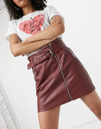 Noisy May faux leather zip front skirt with belt in red