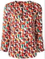 Tucker bam-o-rama front zip blouse