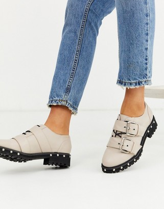ASOS DESIGN Medium chunky studded flat shoes with buckle in beige