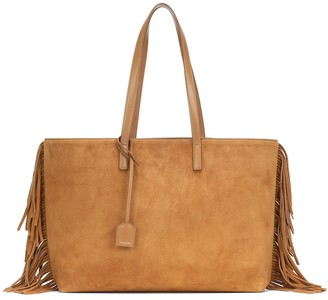 Saint Laurent East West fringed suede tote