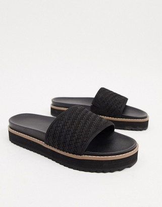 ASOS DESIGN sliders in leather with woven strap and chunky sole