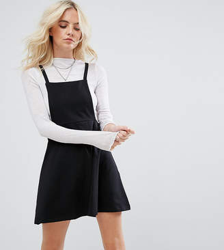 Asos DESIGN Petite mini pinafore dress with strappy back-Black