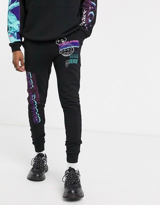 Asos Design DESIGN co-ord skinny joggers in black with multi placement print