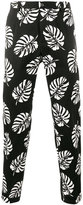 Dolce & Gabbana palm leaf print trousers - men - Cotton/Spandex/Elastane - 48