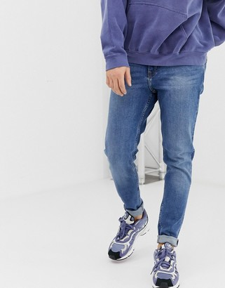 Weekday Cone slim tapered jeans in marfa blue
