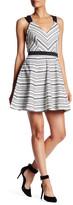 Adelyn Rae V-Neck Sleeveless Crisscross Back Woven Dress