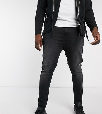 ASOS DESIGN Plus spray on jeans with power stretch in washed black with abrasions