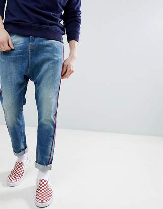 Asos Design DESIGN Drop Crotch Jeans In Mid Wash Neppy Blue With Red Piping
