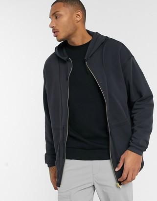 ASOS DESIGN oversized zip up hoodie with heavy wash & seam detailing
