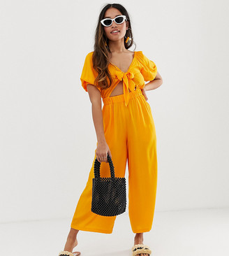 Asos DESIGN Petite tea jumpsuit with puff sleeve and tie detail