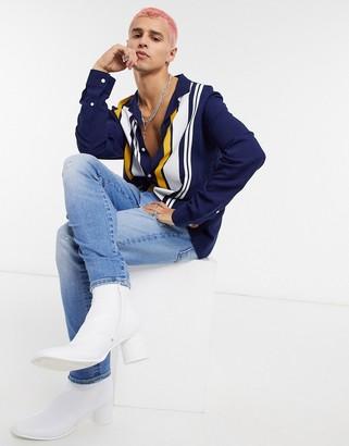 ASOS DESIGN regular revere navy shirt in side placement stripe