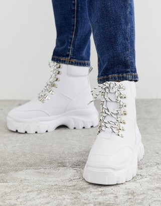 Truffle Collection chunky lace up boots in white