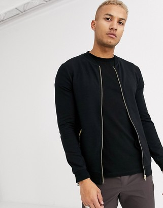 Asos Design DESIGN muscle jersey bomber jacket in black with silver zip pockets