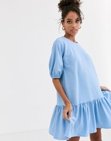 Asos Design DESIGN textured smock dress with tiered hem in blue