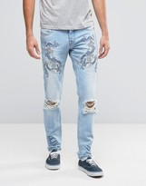 Asos Skinny Jeans With Embroidery In Light Blue