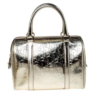 Christian Dior Gold Patent leather Handbags