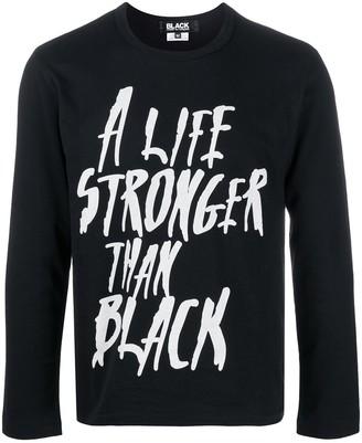 Black Comme Des Garçons slogan-print longsleeved T-shirt