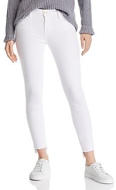 Frame Le Skinny De Jeanne Step Hem Jeans in Blanc